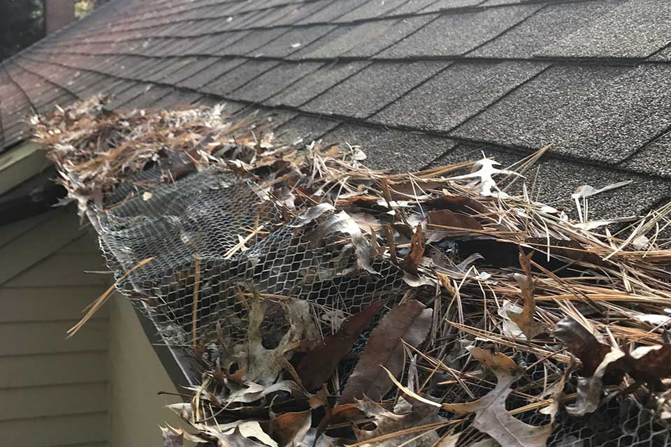 gutter-filled-with-leaves-need-gutter-cleaning-service-grand-rapids-mi